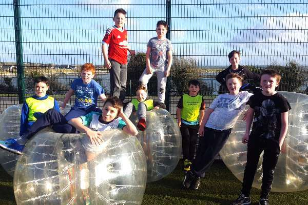 Group of teenagers after playing a round of Bubble Football at a birthday party in Astrobay.