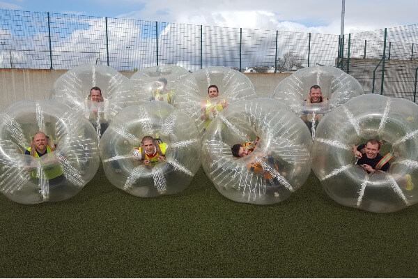 Bubble football group in bubbles pose for team shot!