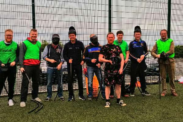 Group of players after Bubble Football and Battle Zone archery games.