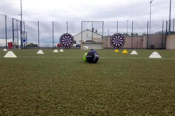 Astro pitch set up for multiple activities for a Stag party